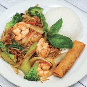 Shrimp Lo Mein plate on a bed of rice, with egg roll.