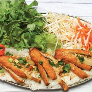 Vietnamese version of grilled shrimp paste on noddles garnished with cucumber, sprouts and carrots.