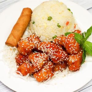 Lunch special sesame chicken on a bed of rice with a egg roll